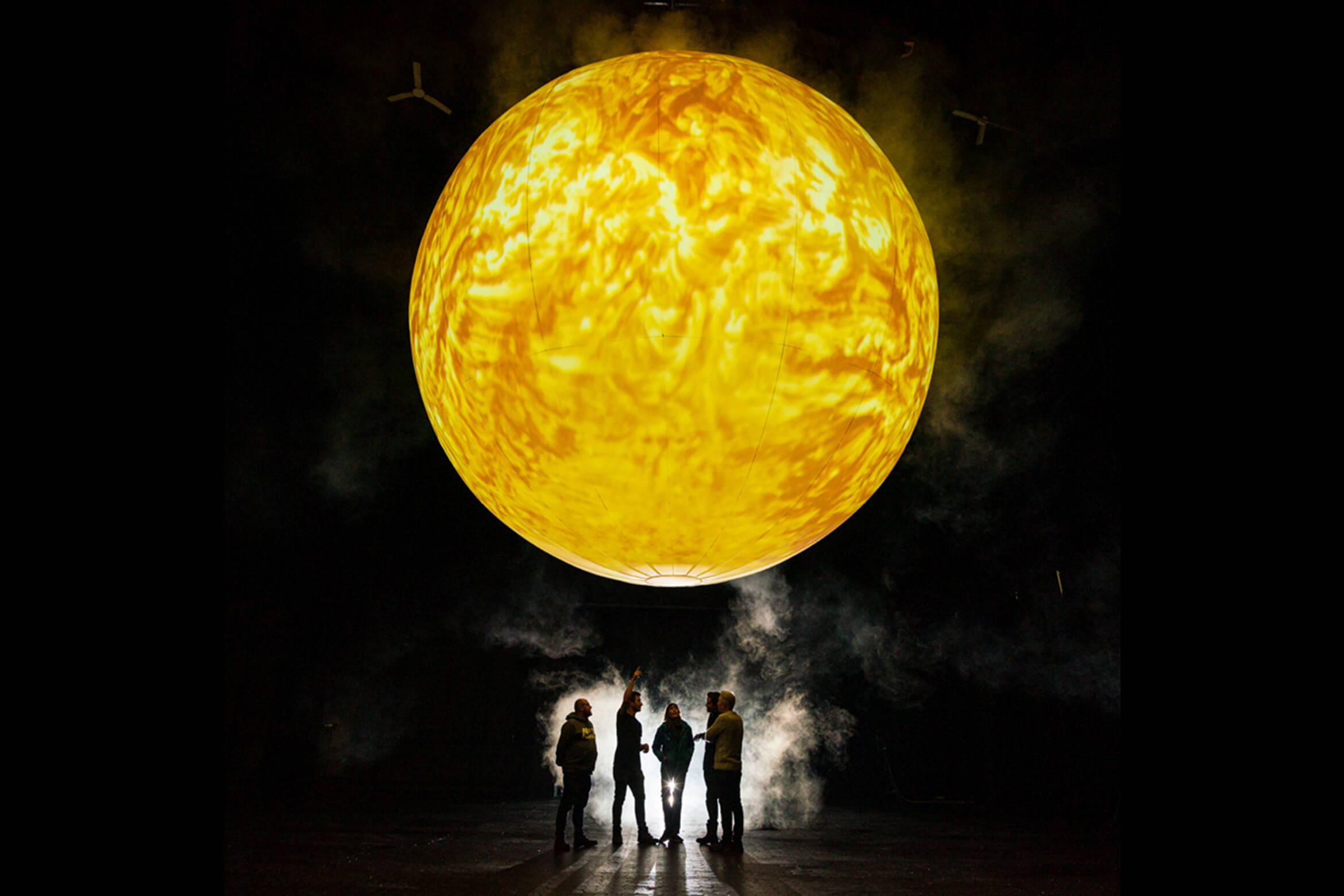 Photograph of SUN with a group of people below
